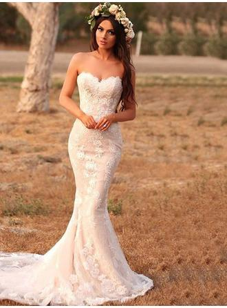 Trumpet/Mermaid Sweetheart Sweep Train Wedding Dresses With Appliques